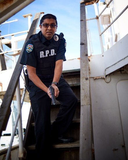 mostawesomesauce.com_Resident_Evil_Siren's_Song_by_Bill_Ried_Rookie_RPD_Cop_Nihil_Naidu_Decending_Stairs