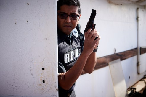 mostawesomesauce.com_Resident_Evil_Siren's_Song_by_Bill_Ried_Rookie_RPD_Cop_Nikhil_Naidu_Taking_Cover