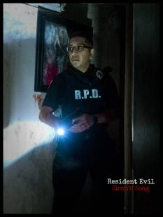 mostawesomesauce.com_Resident_Evil_Siren's_Song_promo_image_featuring_RPD_Cop_Nihil_Naidu_with_A_Sacrifice_To_The_Hellfire