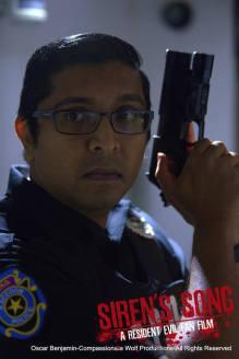 mostawesomesauce.com_Resident_Evil_Siren's_Song_promo_still_by_Oscar_Benjamin_Rookie_RPD_Cop_Nikhil_Naidu